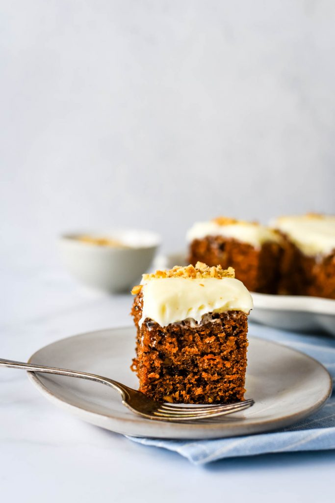 sourdough carrot cake piece on plate with fork