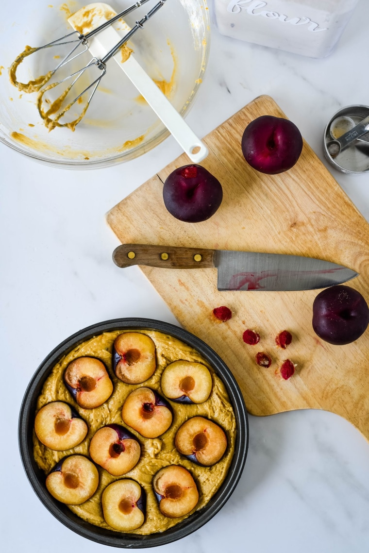 slicing plums for plum cake