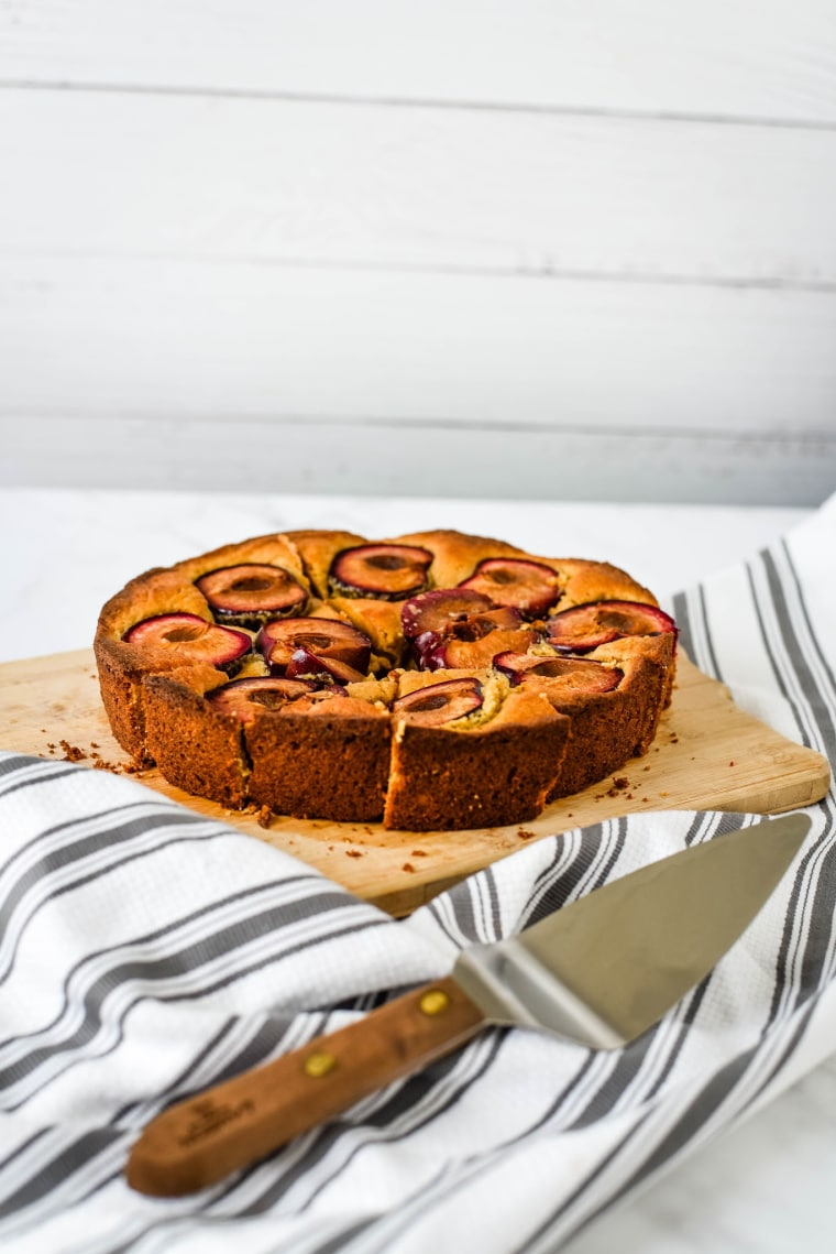 spiced plum cake with serving spatula