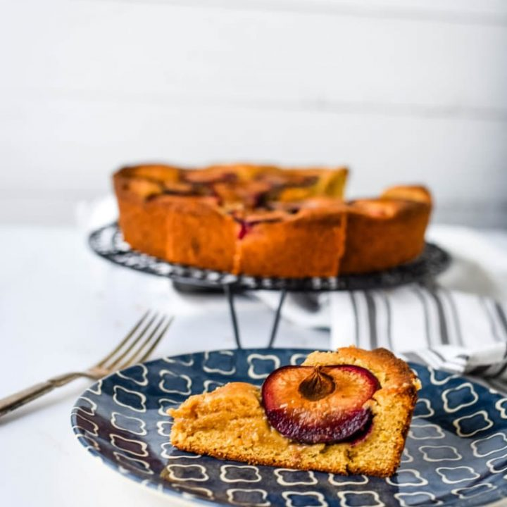plum cake on blue plate with fork