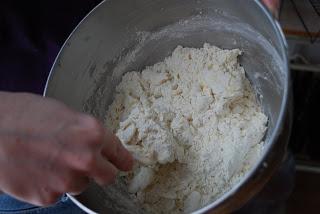 whisking flour in bowl - making lemon lavender cookies
