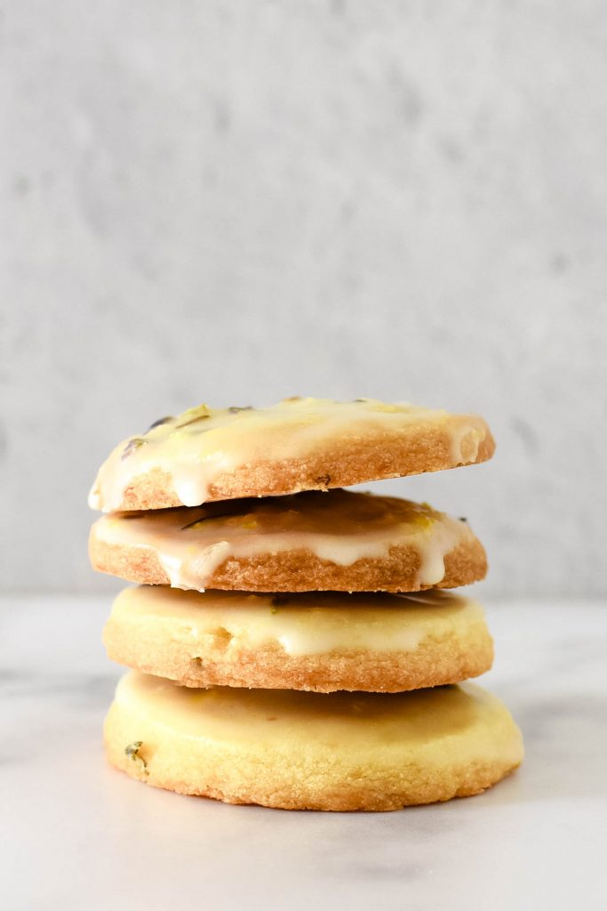 four lemon lavender cookies stacked on top of each other