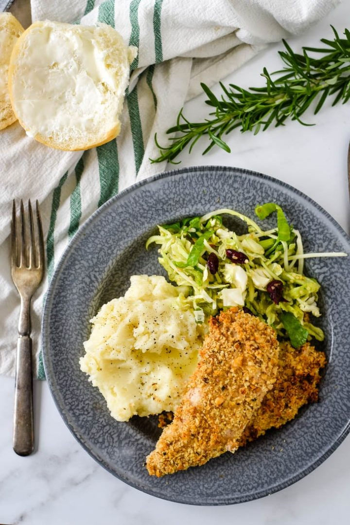 walnut crusted chicken fingers on plate with sides