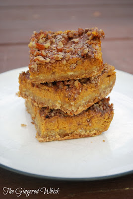a stack of three pumpkin bars on a plate
