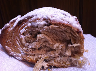 a slice of yeasted stollen on a paper towel