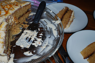 cake on a plate next to cake stand