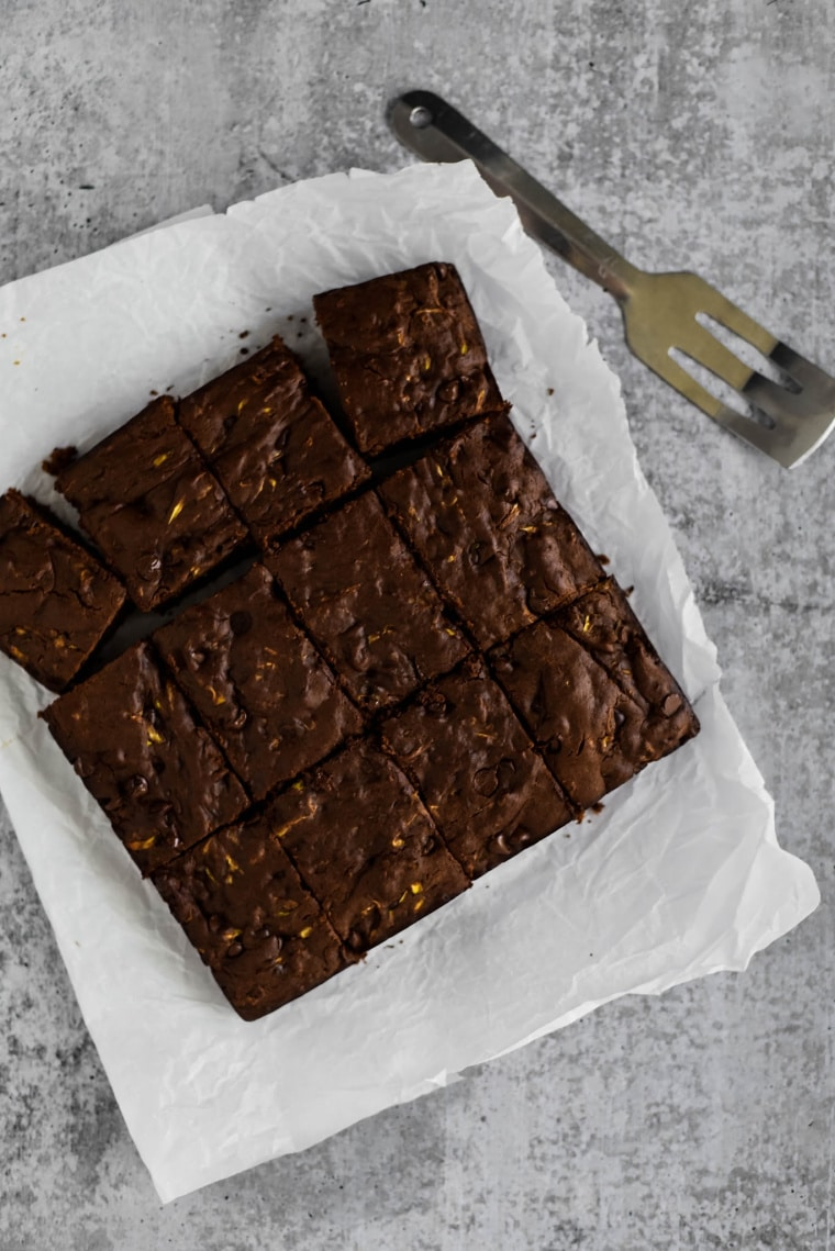 freshly baked zucchini brownies on parchment paper
