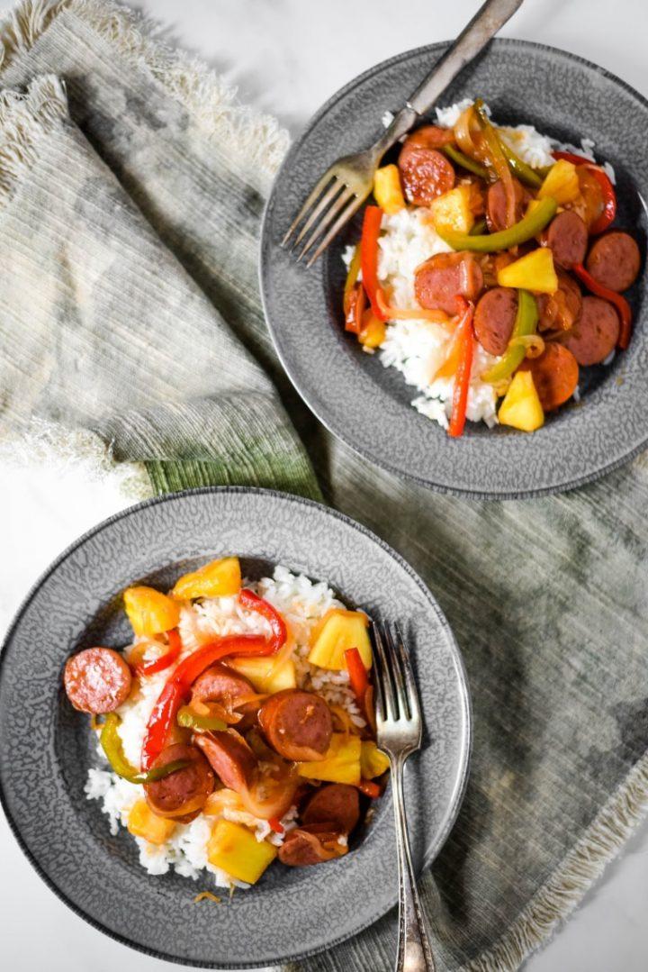 sweet and sour kielbasas on two plates