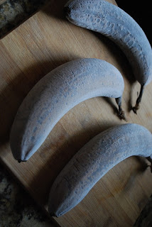 frozen ripe bananas on wooden cutting board for banana date muffins