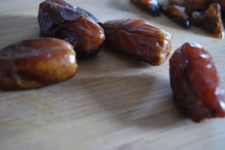 dates on wooden cutting board