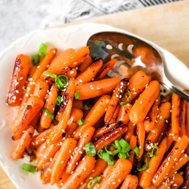 white dish with roasted carrots