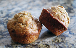 two banana date muffins on granite counter top