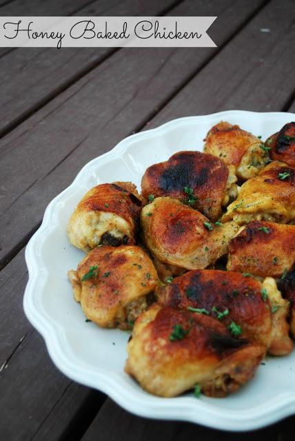 honey baked chicken thighs on white platter