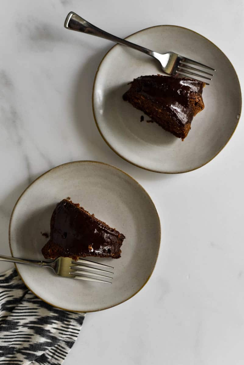 two slices of chocolate sourdough bundt cake on plates with forks
