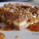 caramel apple cheesecake bars on a plate