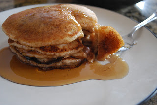 plate of sourdough pancakes with syrup poured on top