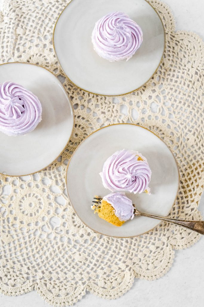 overhead view of cupcakes with fork and bite