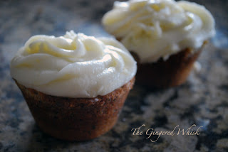 two cupcakes with frosting
