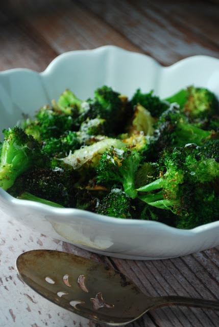 oven roasted broccoli recipe in a white bowl with spoon