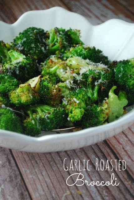 close up image of easy roasted broccoli in white bowl sprinkled with parmesan