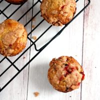 cranberry orange muffins on cooling rack