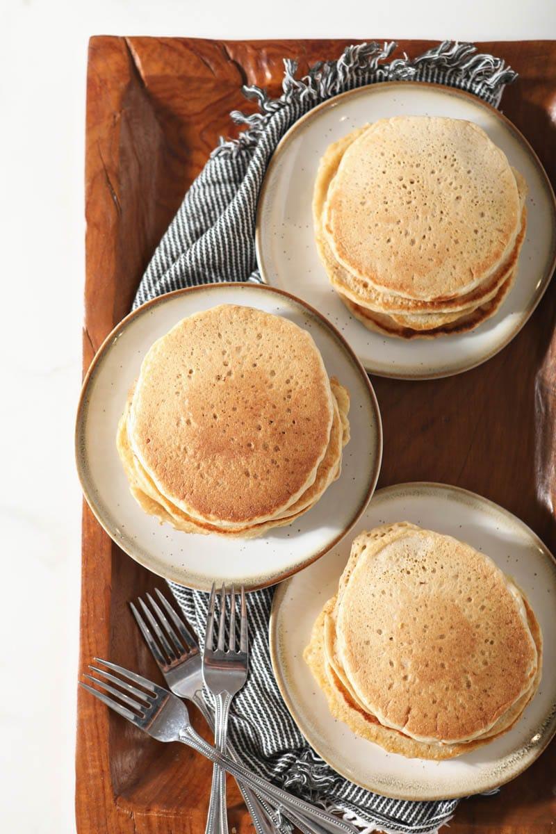 stacks of sourdough pancakes on three plates