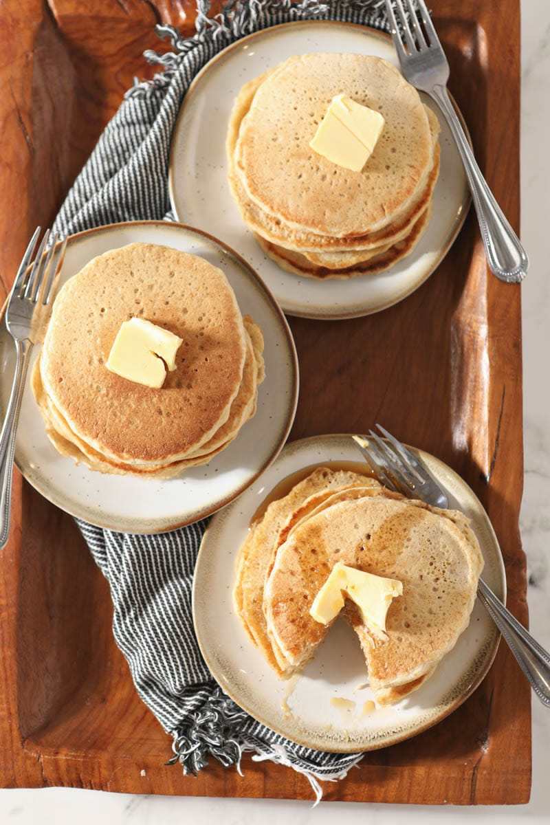 three plates with stacks of sourdough pancakes