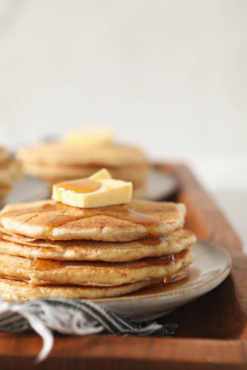 stack of sourdough pancakes with butter and syrup
