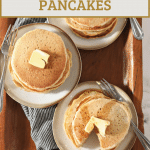 stacks of sourdough pancakes with text overlay for pinterest