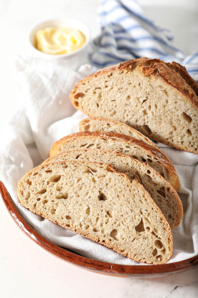 slices of whole wheat sourdough bread on platter
