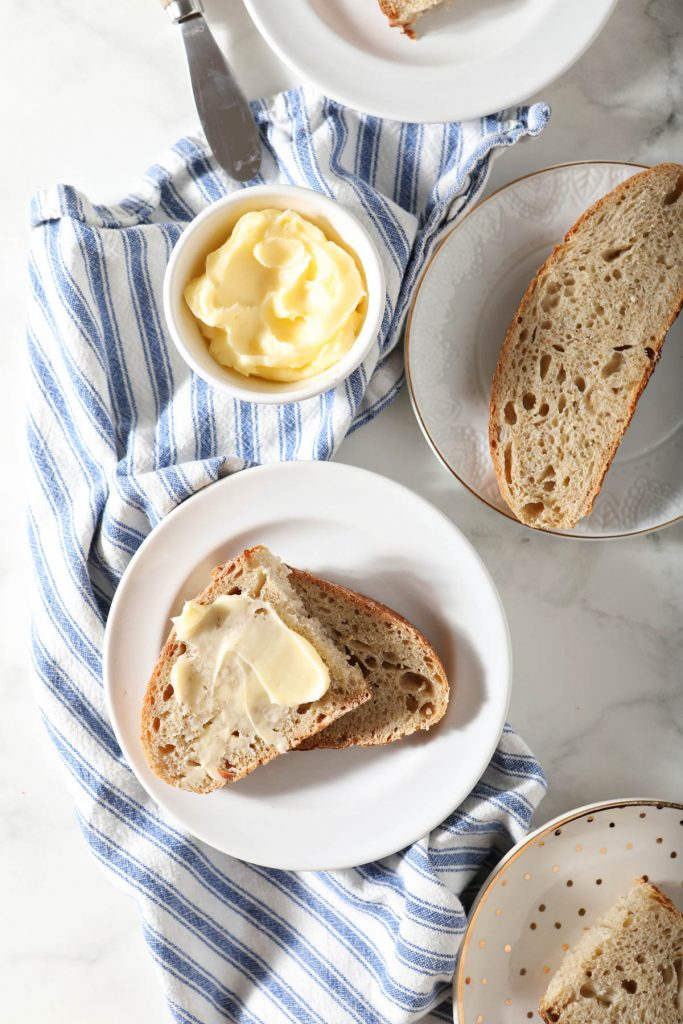 sourdough bread on plates with butter