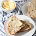whole wheat sourdough slices on plate with butter