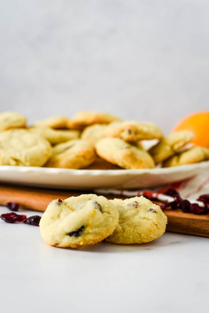 orange cranberry cookies in front of platter