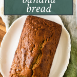 overhead view of sourdough banana bread loaf, with text overlay of recipe name for pinterest