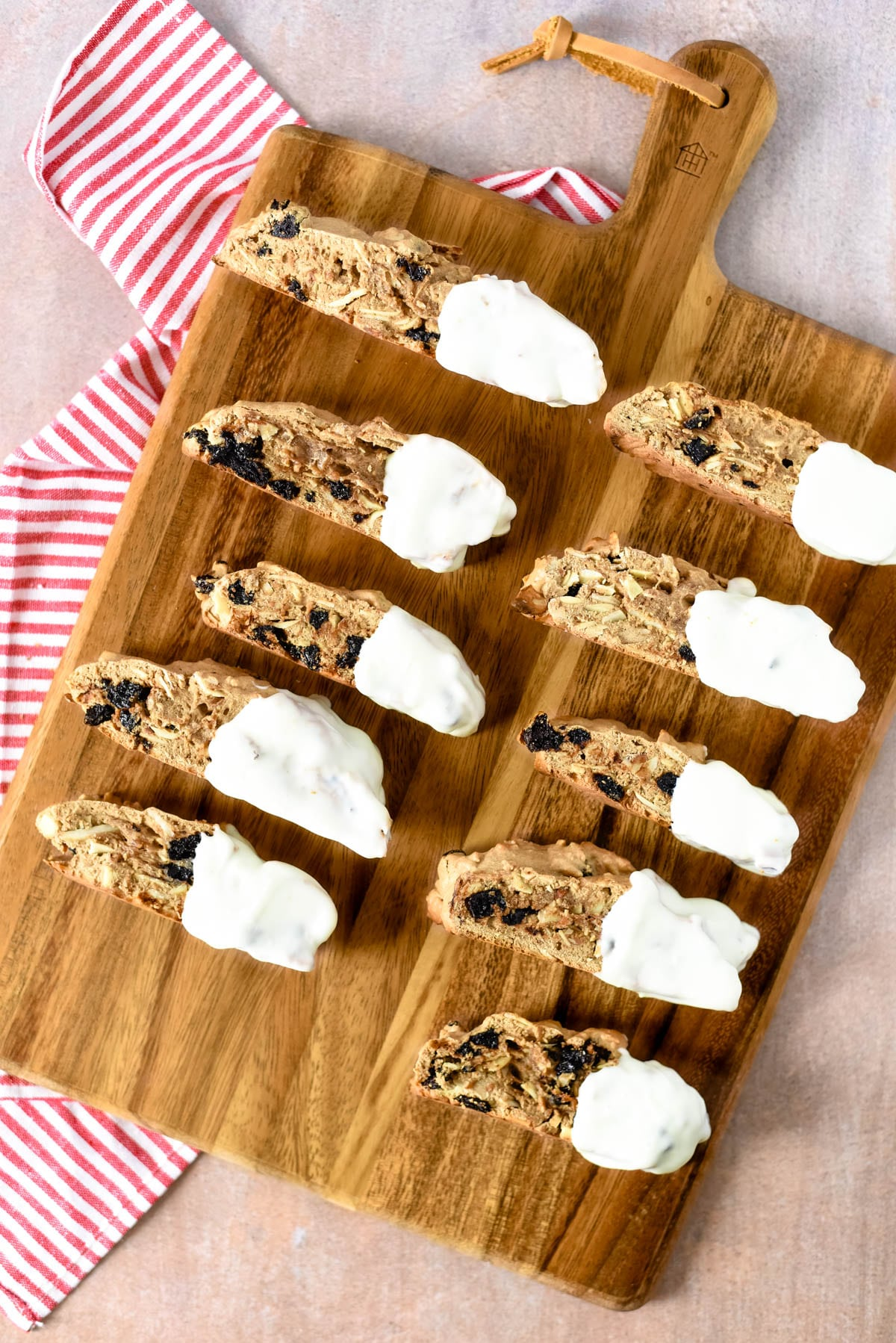 cherry almond biscotti lined on wooden board