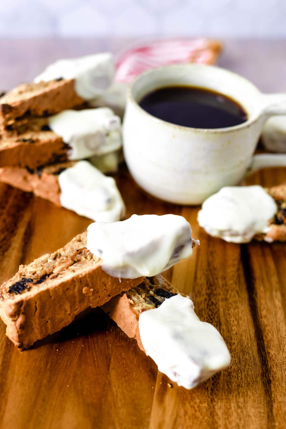 biscotti with white chocolate next to coffee cup