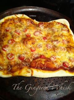 homemade freshly baked pizza on baking sheet