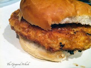 breaded pork tenderloin sandwich on bun