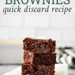 "three sourdough brownies stacked on top of each other with text overlay reading ""sourdough brownies, quick discard recipe"""