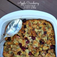 homemade stuffing in white pan with spoon
