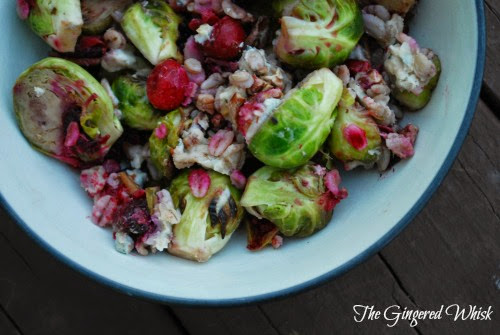 serving bowl with bruises sprouts and cranberries