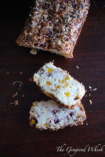 tropical quick bread loaf with two slices cut out