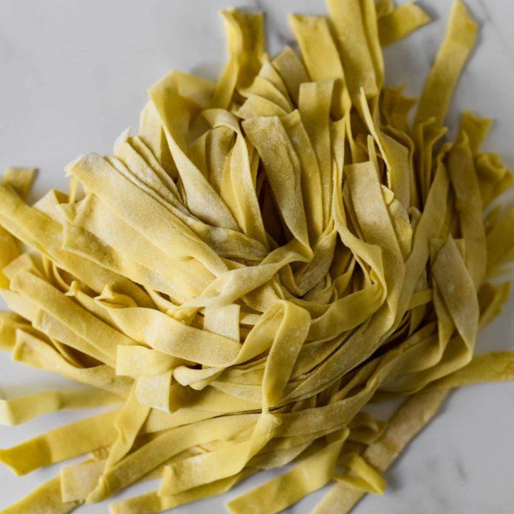 a pile of sourdough pasta noodles on marble