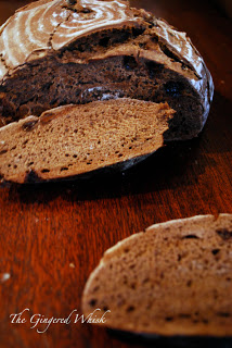 loaf of chocolate bread on wooden table
