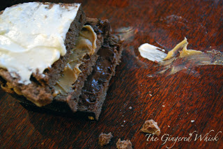 three slices of chocolate bread with butter and peanut butter
