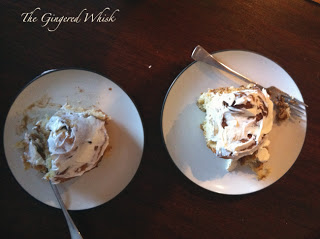 two plates with cinnamon rolls with forks