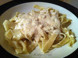 plate of homemade pasta with Alfredo sauce on top