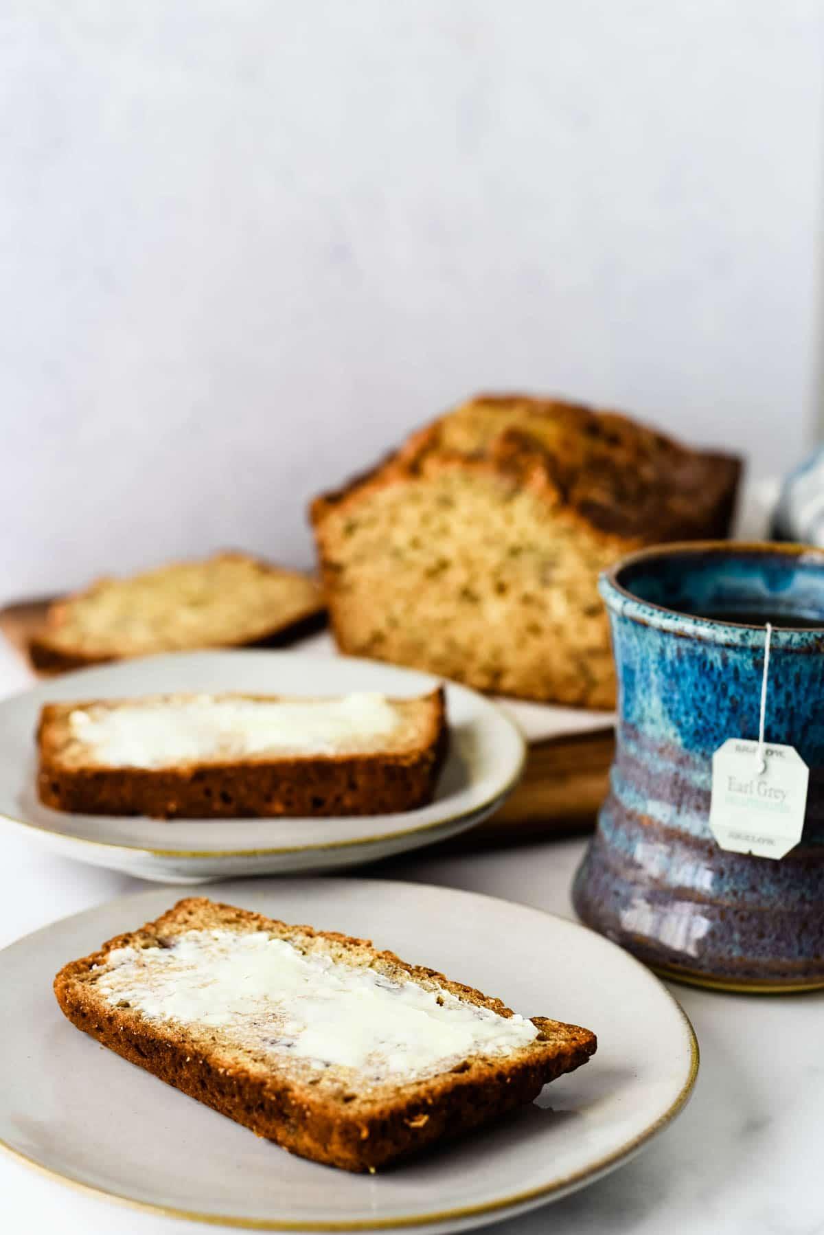 earl grey banana tea cake on plates with mug of tea beside