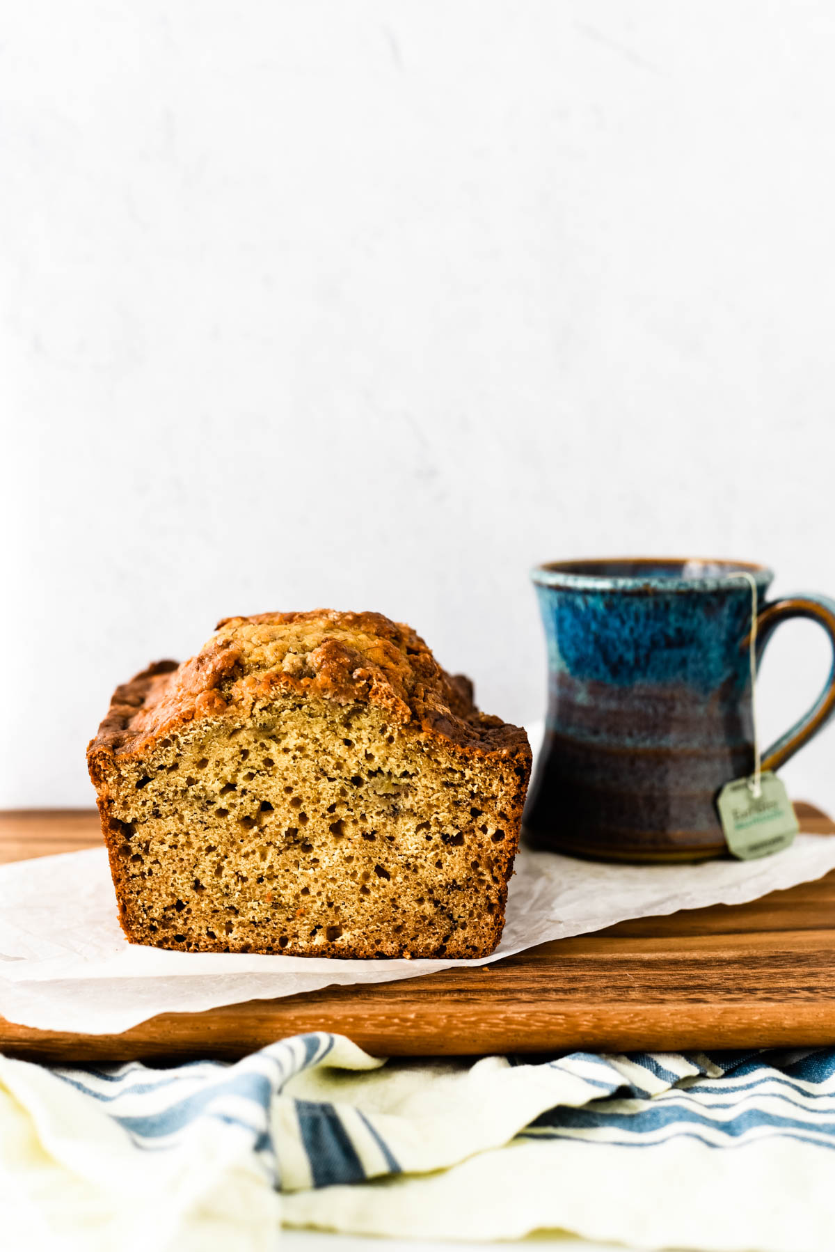 earl grey tea cake loaf with mug of tea beside