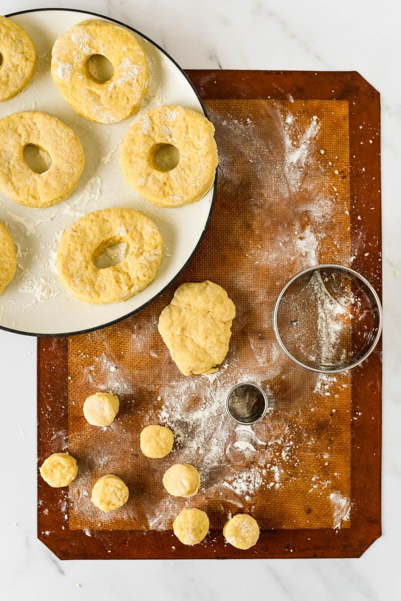 freshly cut sourdough donuts waiting to be fried